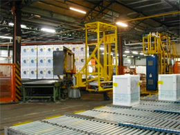 A vertical truck that can load up to 6 washing machines at a time, loading them from the belt conveyor and preparing the shipping.